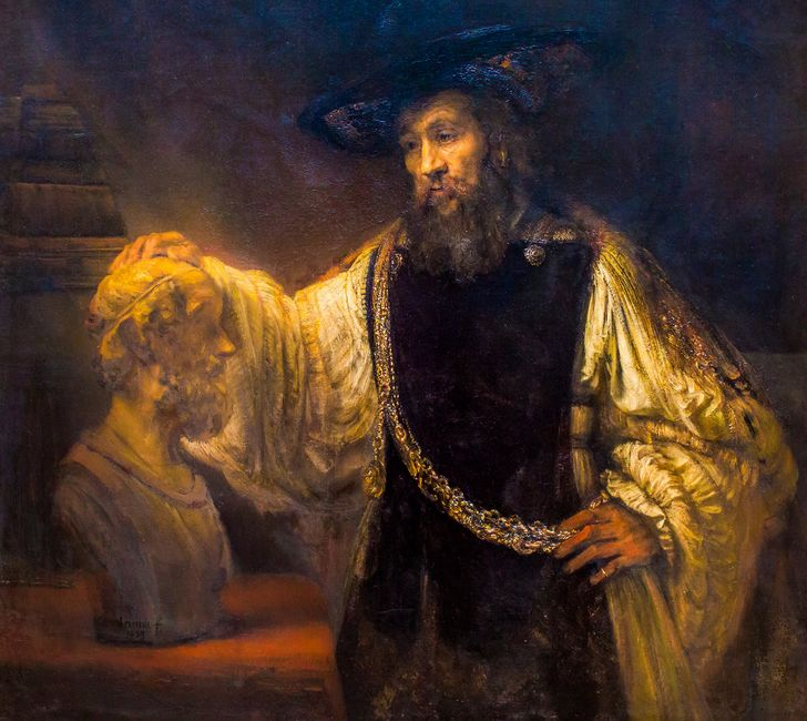 aristoteles con un busto de homero