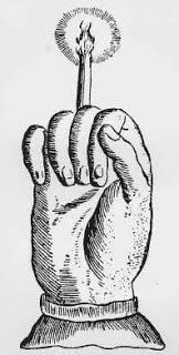 mano-del-muerto-una-vela