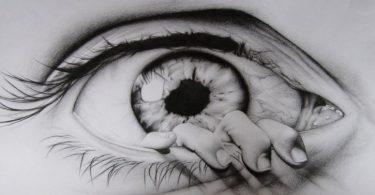 ojo dibujado a lapiz mano saliendo