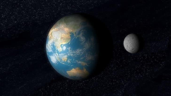 la luna y la tierra en el espacio