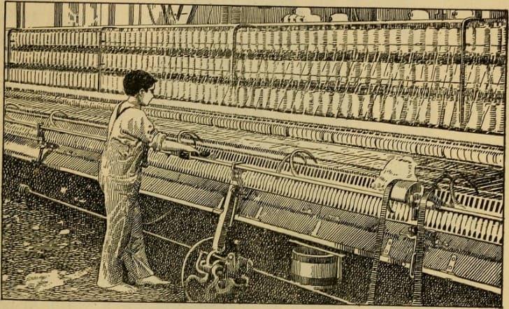 niño trabajando en una fabrica de textiles