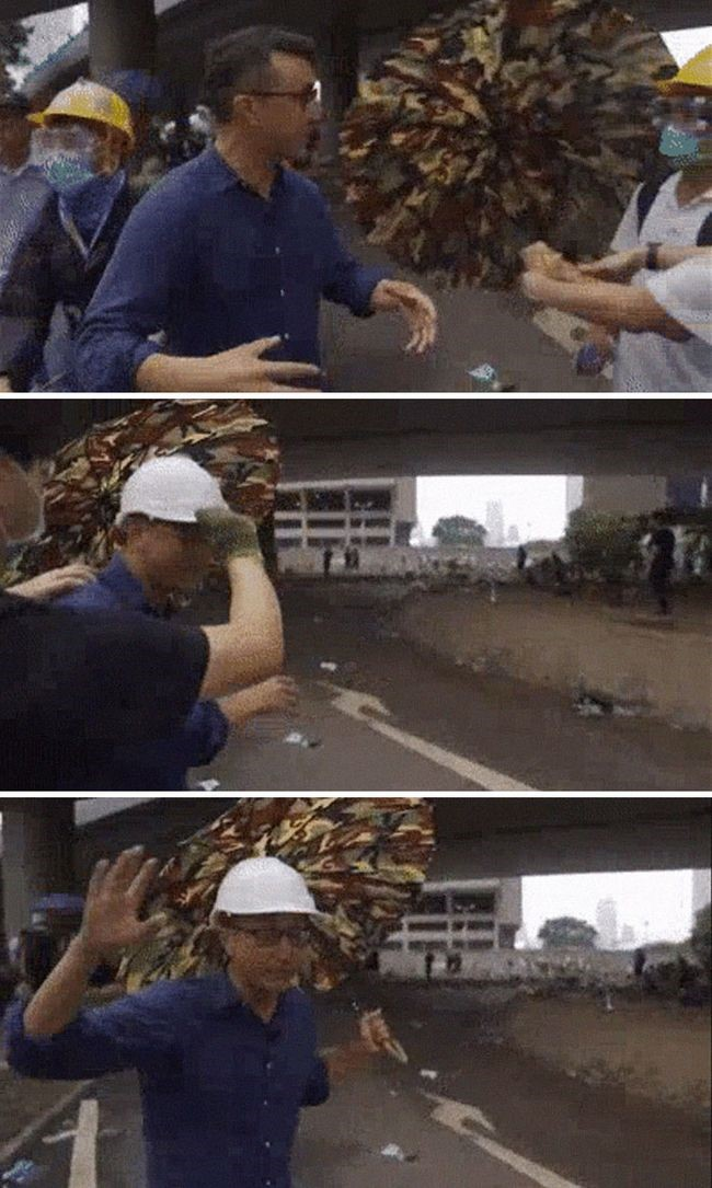 manifestacion ejemplar en hong kong asisten a reportero