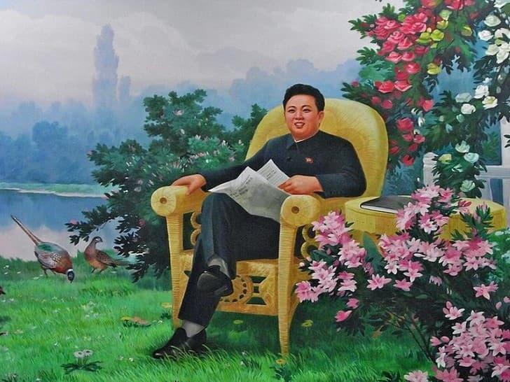 Kim Jong Il sentado en un jardin